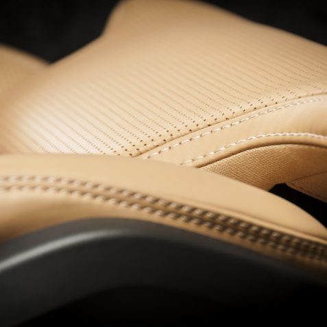 Light brown pefrorated leather new sport car seat