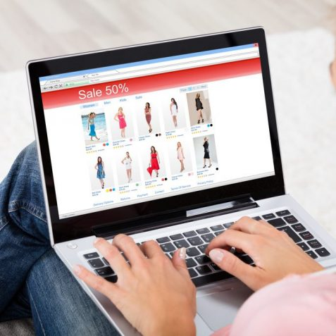 High Angle View Of A Young Woman Shopping Online On Laptop At Home